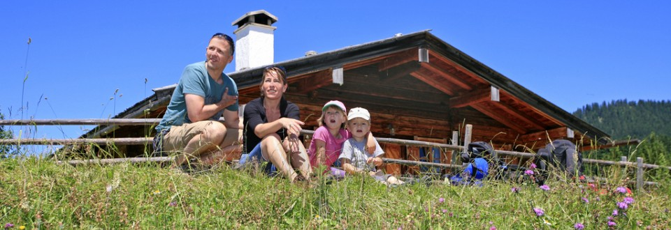 Family Happiness on the Alpine Pastures in Chiemgau.